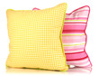 Yellow and pink bright pillows isolated on white