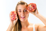 Healthy eating - woman with pomegranate