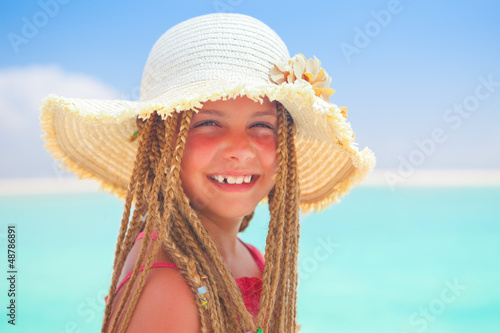girl with straw hat smiling