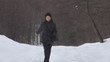 Young woman walking near to forest, winter time