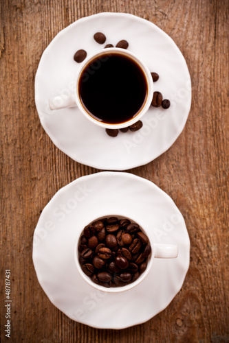 two cups full of coffee
