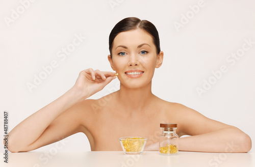 woman with vitamins