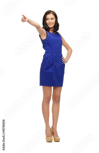 woman in blue dress pointing her finger