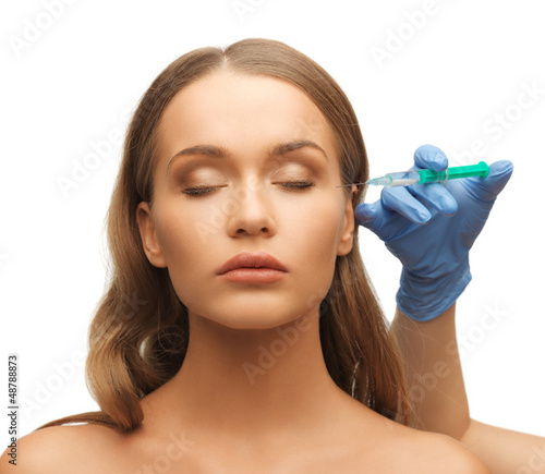 woman face and beautician hands