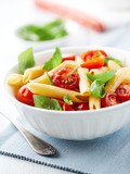 Penne with roasted cherry tomatoes and basil