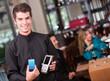 Waiter holding a dataphone
