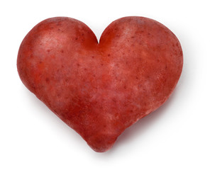 Heart shaped red Potato on a white background.
