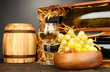 Wooden case with wine bottles, barrel, wineglass and grape