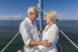 Happy Senior Couple On Front of a Sail Boat