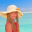 girl with sun hat at tropical destination