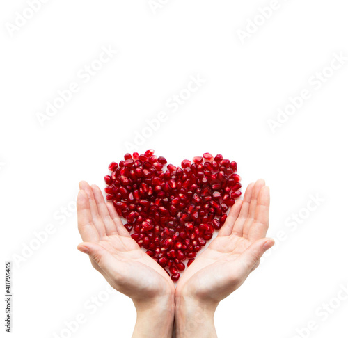 Pomegranate heart in hands