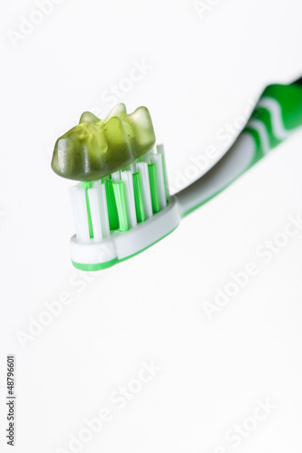 tooth-brush with gummi bear on white