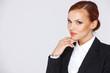 Attractive pensive businesswoman