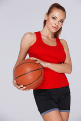 Attractive woman with a basketball