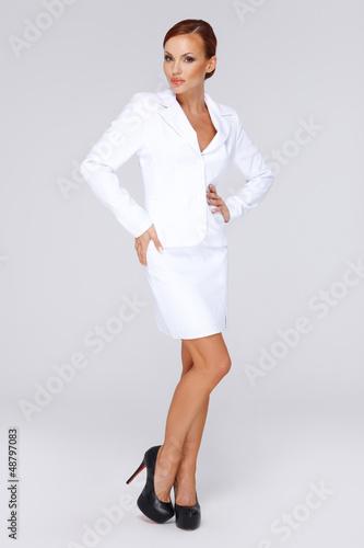 Elegant businesswoman in a white suit