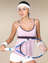 Attractive woman with a tennis racquet