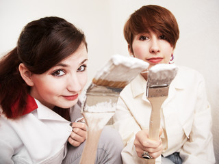 two girls with white paint on the brushes