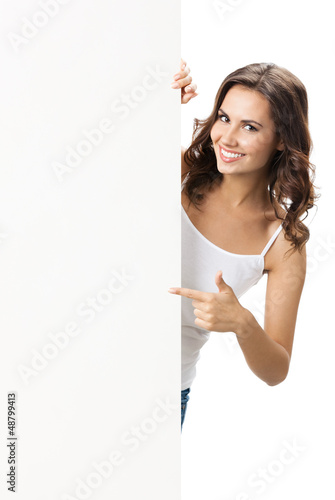 Beautiful young woman with blank signboard