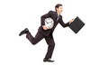 Full length portrait of a businessman running with clock and bri
