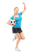 Full length portrait of a happy female holding football and chee