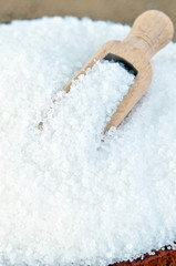 white sugar in the wooden spoon