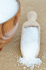 wooden bowl of sugar with wooden spoon
