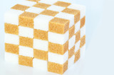 cube of brown and white sugar cubes