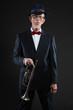 Senior jazz musician. Trumpet player. Studio shot.