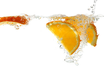 orange slices in water isolated on white