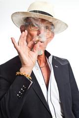 Gangster mafia man smoking cigar. Isolated on white.
