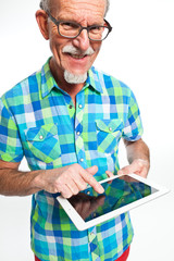 Well dressed senior man with tablet computer. Isolated.