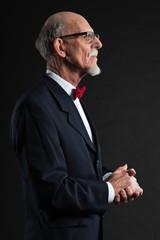 Senior man wearing suit and red tie. Studio shot.