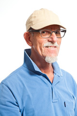 Sportive senior man with cap. Isolated on white.