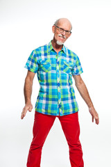 Funny well dressed senior man with glasses. Isolated.