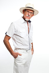 Well summer dressed senior man with hat. Isolated.