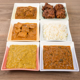 Thali - Indian vegetarian and meat curries, rice and bhajis