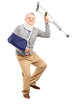 Happy mature gentleman with broken arm holding a crutch