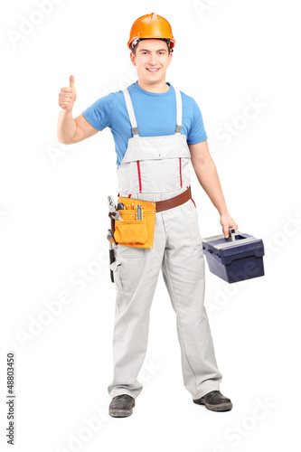 Manual worker holding a tool box and giving a thumb up