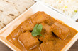 Постер, плакат: Paneer Butter Masala Indian cheese curry with rice & chapati