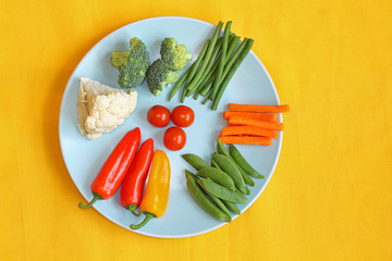 Bright, fresh vegetables on the blue plate