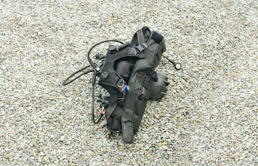 Diving equipment on the grey pebble