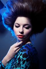 Stylish portrait of a beautiful young woman