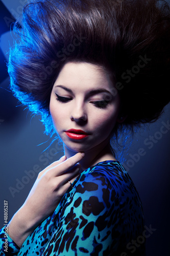 Stylish portrait of a beautiful young woman
