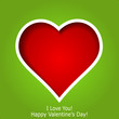 Abstract red heart cutted from green paper background. Valentine