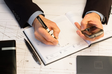 businessman writing business engagement