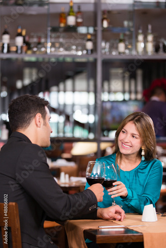Couple toasting at dinner