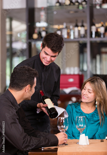 Couple trying wine at a restaurant