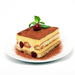 A piece of tiramisu cake on a white plate