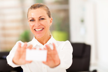 happy senior businesswoman holding business card