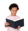 Happy latin child with a book reading